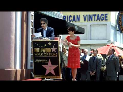 Ray Romano toasts Patricia Heaton at the Hollywood Walk of Fame/Star Ceremony
