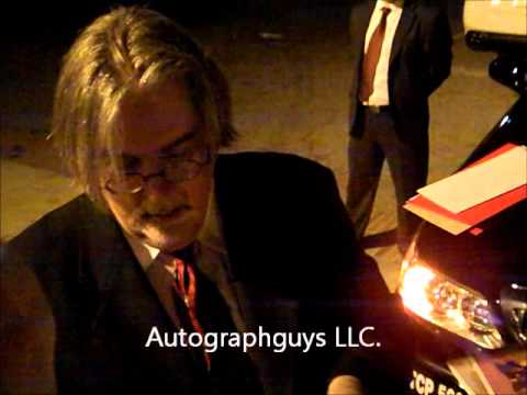 MATT GROENING OF THE SIMPSONS SIGNING AUTOGRAPHS AND DOING SKETCHES AFTER A EVENT IN LOS ANGELES, CA