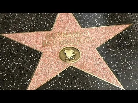 Film director Bernardo Bertolucci visits Hollywood walk of fame star five years late