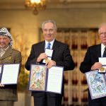Yassar Arafat, Shimon Peres and Yitzhak Rabin with their Peace Prize Medals