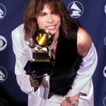 Lead singer for Aerosmith Steven Tyler poses with