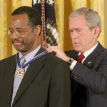 US President George W. Bush presents the Presidential Medal of Freedom on June 19, 2008 to Benjamin Carson, a pediatric neurosurgeon and director of pediatric surgery at Johns Hopkins Hospital in Baltimore, Maryland during ceremonies at the White House in Washington, DC. The Presidential Medal of Freedom, the nation's highest civilian award, recognizes exceptional meritorious service.  AFP PHOTO/Karen BLEIER (Photo credit should read KAREN BLEIER/AFP/Getty Images) ORG XMIT: 81530484