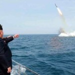 kim points at missile