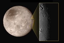 Pluto's moon Charon showing a tall mountain inside a deep depression