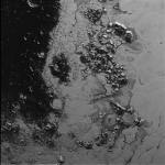 A newly discovered mountain range lies near the southwestern margin of Pluto's heart-shaped Tombaugh Regio (Tombaugh Region), situated between bright, icy plains and dark, heavily-cratered terrain. This image was acquired by New Horizons' Long Range Reconnaissance Imager (LORRI) on July 14, 2015, from a distance of 48,000 miles (77,000 kilometers) and sent back to Earth on July 20. Feature as small as a half-mile (1 kilometer) across are visible. These frozen peaks are estimated to be one-half mile to one mile (1-1.5 kilometers) high, about the same height as the United States' Appalachian Mountains. The Norgay Montes (Norgay Mountains) discovered by New Horizons on July 15 more closely approximate the height of the taller Rocky Mountains.