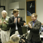 At just before noon EST on Feb. 28, 2007, (from left) Science Co-investigator John Spencer, Program Scientist Denis Bogan, Project Scientist Hal Weaver, Principal Investigator Alan Stern and Mission Operations Manager Alice Bowman applaud upon confirming New Horizons' successful Jupiter flyby in the New Horizons Mission Operations Center at the Johns Hopkins University Applied Physics Laboratory in Laurel, Md.