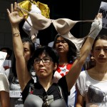 Protesters wear bras over their shirts during a demonstration in support of local female protester Ng Lai-ying, outside the police headquarters in Hong Kong, China August 2, 2015. Ng was sentenced to three and a half months in jail for using her breast to bump against police at an anti-parallel trading protest, local media reported.   REUTERS/Liau Chung-ren