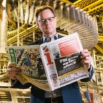 Ashely Highfield reads i newspaper