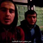 "A still image taken on August 19, 2016 from an August 18, 2016 video posted on social media shows two Islamic State spokespersons of the Islamic State, as they claim responsibility for an attack on a traffic police post outside Moscow, Russia. The Arabic text (bottom) reads, ""We are mujahideen of the Islamic State"".   Social Media"