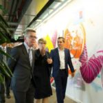 (L-R) German Interior Minister Thomas de Maiziere, Eva- Maria Kirschsieper, Facebook head of public policy D-A-CH and Martin Ott, Facebook managing director central Europe, walk during a visted at the Facebook office in Berlin, Germany